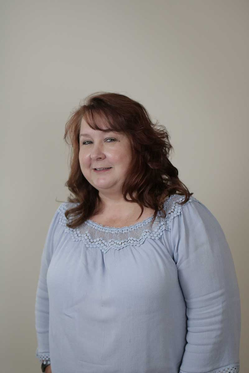 Headshot of office staff member Denise